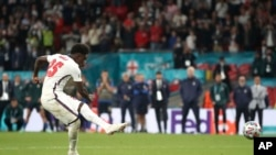 England's Bukayo Saka has his shot saved in the penalty shoot-out during the Euro 2020 soccer championship final match between England and Italy at Wembley Stadium in London, July 11, 2021.