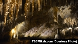A typical cave at Carlsbad Caverns National Park in southern New Mexico. Stalactites, which hang like icicles from the ceiling, are made up of calcium salts and other minerals deposited by dripping water.