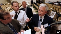 FILE - Ron Stotish, CEO of AquaBounty, the company that applied with the Food and Drug Administration to market genetically modified salmon, speaks to reporters at an FDA advisory committee hearing in Rockville, Md., Sept. 20, 2010.