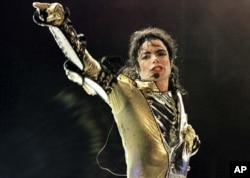 FILE - Michael Jackson performs during a concert in Vienna
