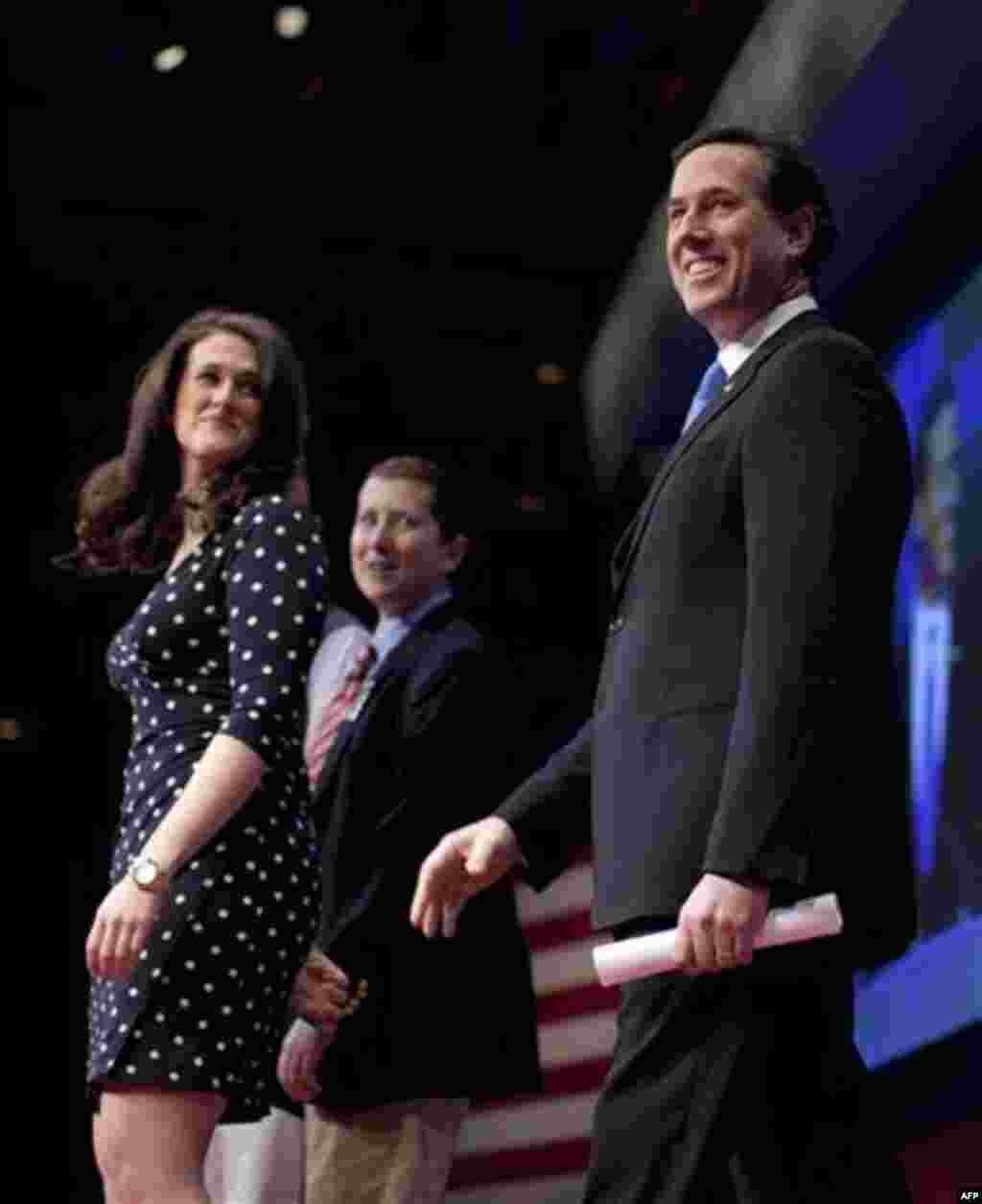 Republican presidential candidate, former Pennsylvania Sen. Rick Santorum arrives to speak at the Conservative Political Action Conference, Friday, Feb. 10, 2012, in Washington. (AP Photo/Evan Vucci)