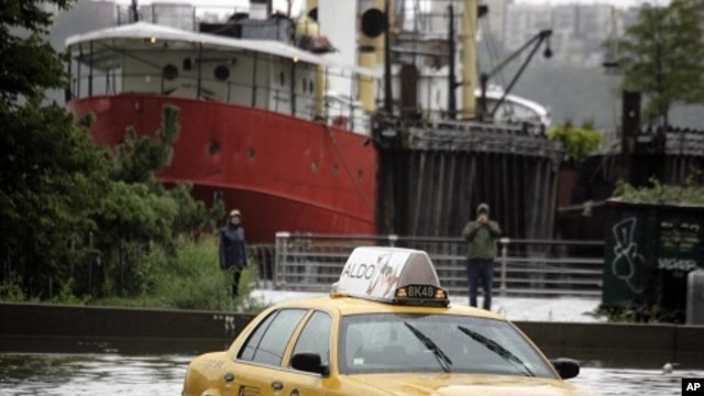A New York City taxi is stranded in deep water on Manhattan's West Side as Tropical Storm Irene passes through the city, in New York August 28, 2011