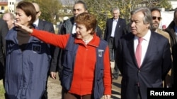 EU Commissioner for International Cooperation, Humanitarian Aid and Crisis Response Kristalina Georgieva gestures during a visit with United Nations High Commissioner for Refugees (UNHCR) Antonio Guterres (R) to Saadnayel in the Bekaa valley December 15, 2012.