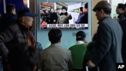 "People watch a TV news program showing North Korean leader Kim Jong Un with superimposed letters that read: ""North Korea has made nuclear warheads small enough to fit on ballistic missiles"" at Seoul Railway Station in Seoul, South Korea, Wednesday, March"
