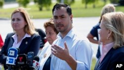 FILE - Rep. Joaquin Castro, D-Texas, second from right, speaks during a news conference after touring the Homestead Temporary Shelter for Unaccompanied Children, in Homestead, Fla., Feb. 19, 2019.