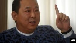 前汉龙集团董事长、四川富豪刘汉(2011年1月16日资料照)