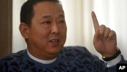 Ông Liu Han (trong ảnh), cựu chủ tịch tập đoàn năng lượng Hanlong của tỉnh Tứ xuyên, và em trai là ông Liu Wei nằm trong số 36 người bị buộc tội
