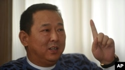 FILE - Liu Han, the former multimillionaire chairman of energy conglomerate Sichuan Hanlong Group.