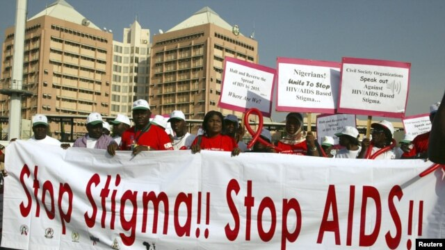 People holding banners march to campaign for increased aids awareness in the streets of Nigeria's capital Abuja December 1, 2006 on World Aids Day.
