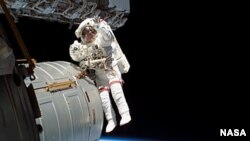 Astronaut Jeffrey Williams during a six-hour space walk mission outside the International Space Station.
