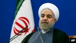 Iran's President Hassan Rouhani, speaking in Tehran on the second anniversary of his election, vowed that his nation wouldn't allow state secrets to be jeopardized under the cover of nuclear inspections, June 13, 2015.