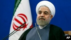 Iran's President Hassan Rouhani, speaking at a Tehran news conference on the second anniversary of his election, June 13, 2015.