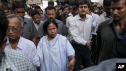 Indian Railway Minister and leader of the Trinamool Congress party Mamata Banerjee meets with people outside her home, a day before results for the state elections are announced, in Kolkata, India, May 12, 2011