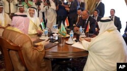 Seated from left clockwise at table, Saudi Foreign Minister Adel al-Jubeir, United Arab Emirates Foreign Minister Abdullah bin Zayed al-Nahyan, Egyptian Foreign Minister Sameh Shoukry, and Bahraini Foreign Minister Khalid bin Ahmed al-Khalifa meet in Cair
