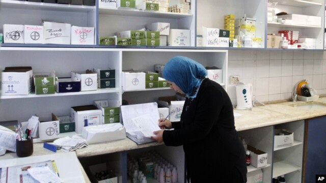 A pharmacist works in the Ramallah Hospital.