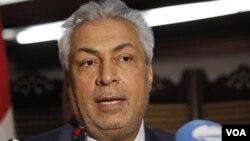 Iraq's Minister of Oil Abdul-Karim Elaibi speaks to the media in Baghdad, Iraq, Wednesday, May 30, 2012. (AP Photo/Karim Kadim)