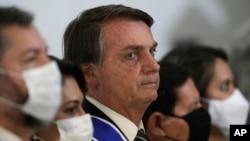 2020年10月22日,巴西总统贾伊尔·博尔索纳罗在巴西巴西利亚的伊塔马拉蒂宫参加庆祝外交官日的仪式。