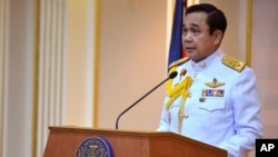 Prayuth Chan-ocha speaks after he accepted a written royal command issued by King Bhumibol Adulyadej certifying his appointment.