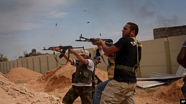 Libyan provisional government fighters attacking pro-Gadhafi forces in Sirte, Oct. 7, 2011.