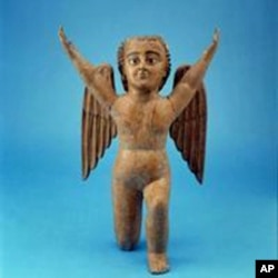 This cherub from the museum's collection was fashioned of painted wood and glass eyes in the mid-1700s, after Spanish Catholics had introduced the concept of angels.