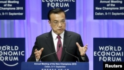China's Premier Li Keqiang delivers a speech earlier this year at a World Economic Forum Event.