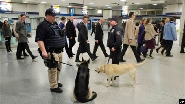 Police officers and their dogs on duty in Penn Station, April 16, 2013 in New York City