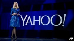 FILE - Yahoo President and CEO Marissa Mayer speaks during the International Consumer Electronics Show in Las Vegas, Jan. 7, 2014.