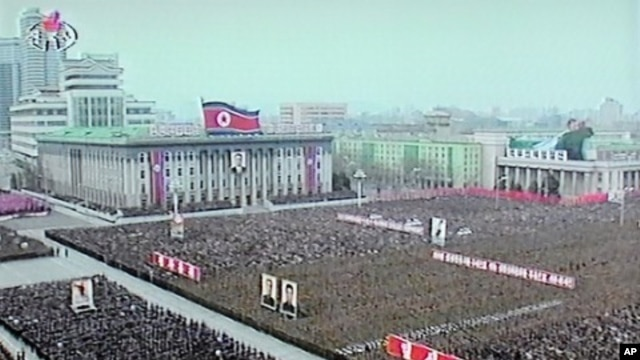 North Korea's state television shows troops and civilians at Pyongyang's Kim Il Sung Square on April 20, 2012.