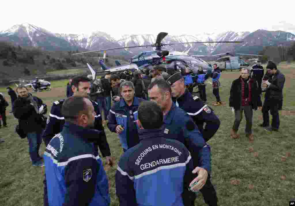 Rescue workers and gendarme gather in Seyne-les-Alpes, French Alps, as they struggle to reach the remote crash site of Germanwings passenger plane, March 24, 2015.