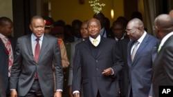 Self-proclaimed transitional president Michel Djotodia, right, met with Kenya's President Uhuru Kenyatta, left, Uganda's President Yoweri Museveni, center, to discuss the crisis at UN offices in Nairobi, July 31, 2013.