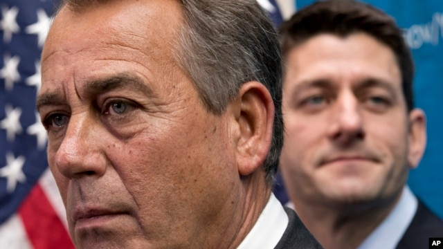 House Speaker John Boehner of Ohio, left,  joined by House Budget Committee Chairman Rep. Paul Ryan, R-Wis., takes reporters' questions, on Capitol Hill in Washington, Dec. 11, 2013.