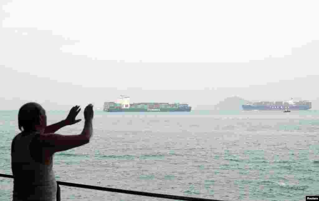 A man exercises at the Sai Wan Swimming Shed in Hong Kong, China, October 7, 2018. REUTERS/Hannah McKay