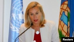 Sigrid Kaag, special coordinator of the Organization for the Prohibition of Chemical Weapons-United Nations (OPCW-UN) joint mission on eliminating Syria's chemical weapons program, speaks during a news conference in Damascus, April 27, 2014.