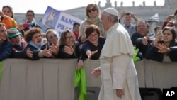 Faithful and tourists reach out to Pope Francis as he arrives for his weekly general audience, in St. Peter's Square at the Vatican, April 6, 2016. (AP Photo/Andrew Medichini)