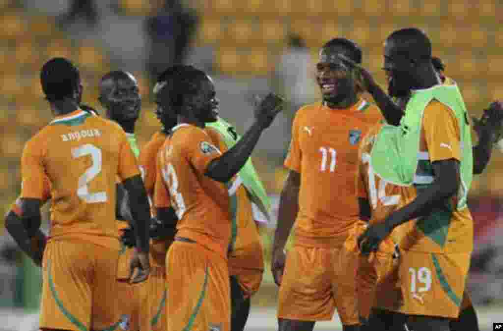 "Ivory coast's players celebrate their win after their African Nations Cup soccer match against Angola at Estadio de Malabo ""Malabo Stadium"", in Malabo January 30, 2012. At second right is Didier Drogba."