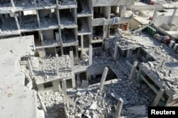 View of buildings damaged by what activists said were missiles fired by a Syrian Air Force fighter jet loyal to President Bashar al-Assad at Jessreen area in Ghouta, east of Damascus, December 2, 2012.