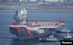 FILE PHOTO - China's first domestically built aircraft carrier is seen during its launch ceremony in Dalian, Liaoning province, China, April 26, 2017.