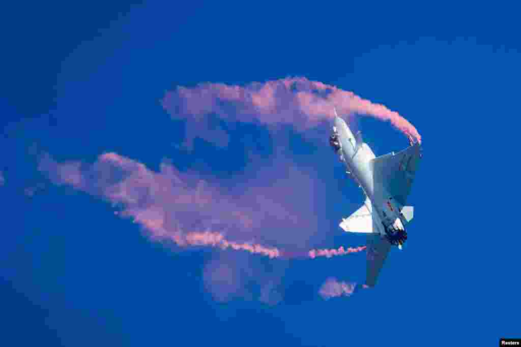 A J-10B fighter jet of the Chinese People's Liberation Army Air Force (PLAAF) performs during the China International Aviation and Aerospace Exhibition, or Zhuhai Airshow, in Zhuhai, Guangdong province.