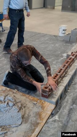 High school students from the Waterloo Community School District take part in construction traning at their school. The students spent five days at their school learning from experienced workers from the Masonry Institute of Iowa. (Masonry Institute of Io