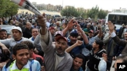 Egyptian protesters shout slogans as they gather to call for the trial of members of ousted President Hosni Mubarak in front of a court in Cairo, Egypt, March 8, 2011