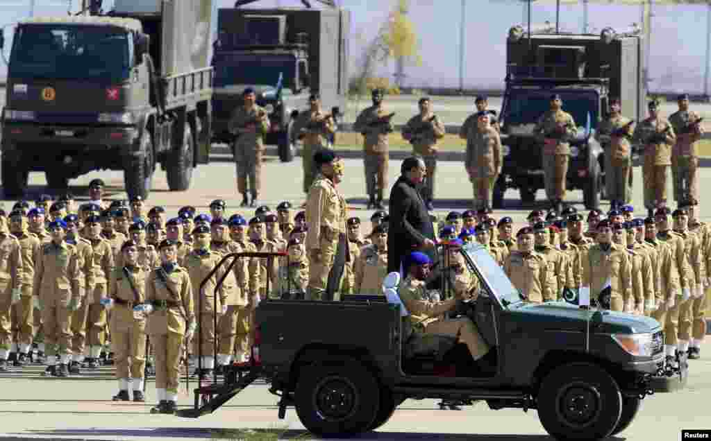Pakistan's President Mamnoon Hussain inspects troops during Pakistan Day parade in Islamabad, March 23, 2015.