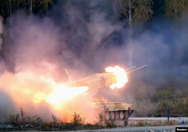 "FILE - A Russian ""TOS-1 Buratino"" multiple rocket launcher fires during the ""Russia Arms Expo 2013"" 9th international exhibition of arms, military equipment and ammunition, in the Urals city of Nizhny Tagil. The U.S. and Russia's weapons exports grew by 27 and 28 percent respectively during the period."