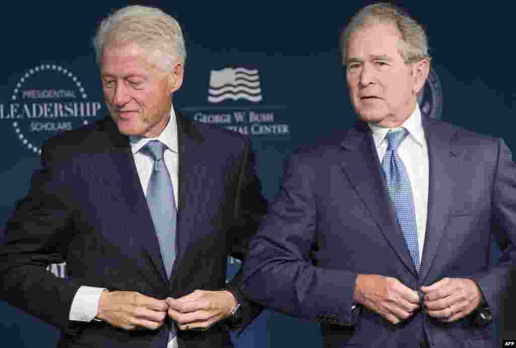 Former U.S. President Bill Clinton and President George W. Bush stand to leave after speaking during the launch of the Presidential Leadership Scholars Program at the Newseum in Washington, DC.