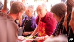 The Dalai Lama helps serve lunch at a San Francisco soup kitchen on Sunday, April 26, 2009.