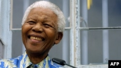 Former South African president Nelson Mandela shown in a 2003 file photo.
