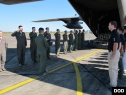 Members from Defense POW/MIA Accounting Agency (DPAA), conduct a dignified transfer ceremony for possible human remains during a DPAA investigation mission at the Diburgarh Airport, Arunachal Pradesh, India, Dec. 13, 2016.