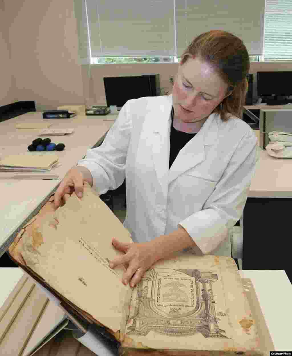 IJA conservator Katherine Kelly works on an artifact. (U.S. National Archives)