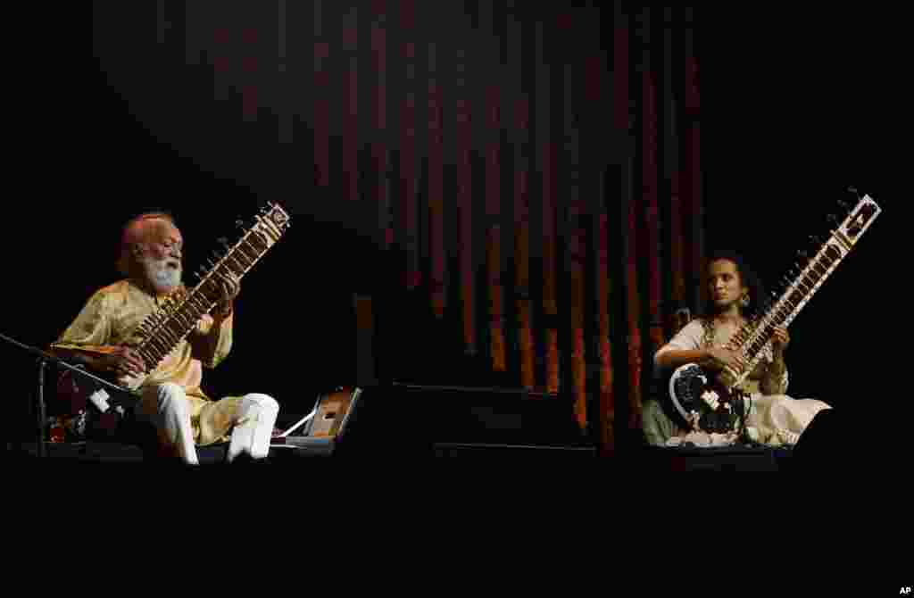 Indian musician and sitar maestro Ravi Shankar at a performance with his daughter Anoushka Shankar, Bangalore, India, February 7, 2012.