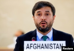 Afghanistan Ambassador Nasir Ahmad Andisha speaks during a special session of the Human Rights Council on the situation in Afghanistan, at the European headquarters of the United Nations in Geneva, Aug. 24, 2021.