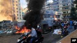 Saad Hariri's supporters block streets in Beirut, Lebanon, Thursday, July 15, 2021.